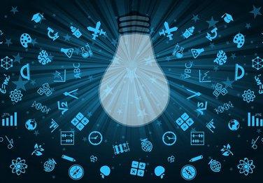 grafika przedstawiająca żarówkę oświetlającą przybory szkolne